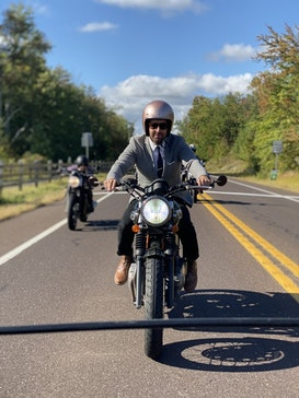 I am wearing a very cute pink sparkly helmet that gives me a nice big bobble head. Triumph Thruxton. Cafe Racer. The Distinguished Gentleman's Ride